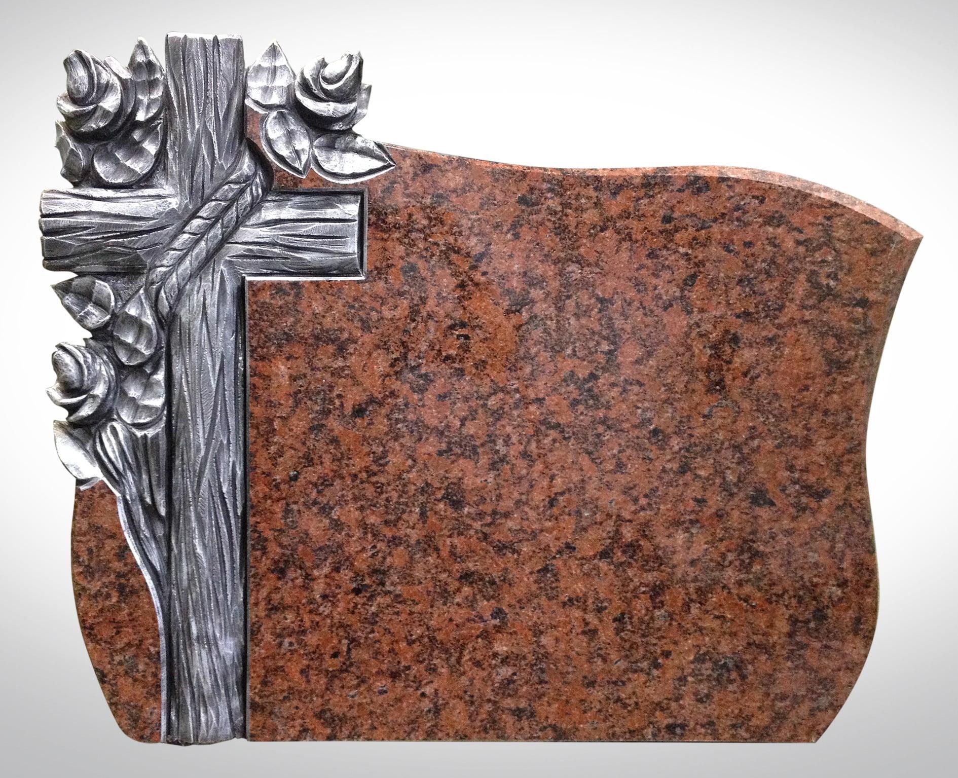 Nagrobek z drewnianym krzyżem i gałązkami
